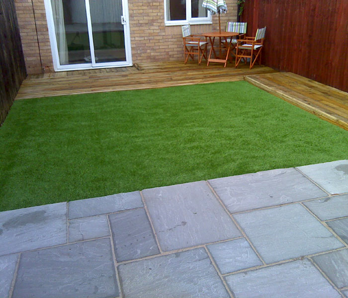 Artificial grass companies what to look for when for Garden decking and slabs